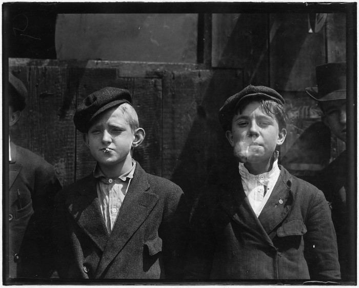 7.11:00 A.M., May 1910:   Newsies at Skeeter's Branch in St. Louis. They were all smoking.