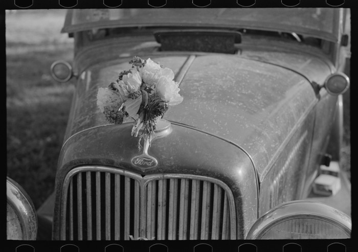 7.	Ornament on the radiator cap of an automobile, Sikeston, August 1938.