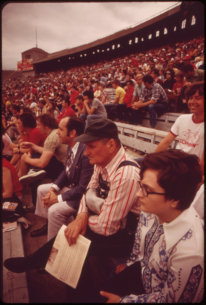 11. Football fans enjoy the game, May 1973.