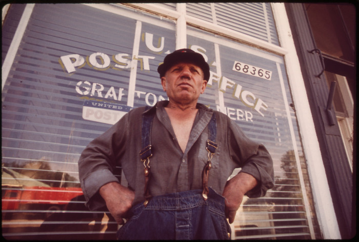 """5. From the original caption: """"Charlie Gross outside Grafton post office. A former farmer truck driver, boxer, dog raiser and salesman, he has lived in Nebraska more than half his life, May 1973."""""""