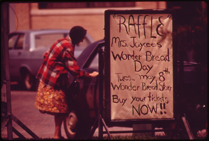 22. A fundraiser sign sits in front of the Jefferson County courthouse in Fairbury, May 1973.
