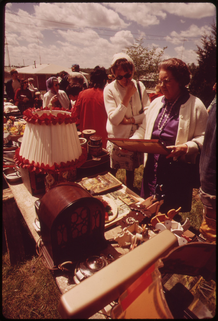 24. Shoppers look over items at a Saturday auction near Hickman, May 1973.