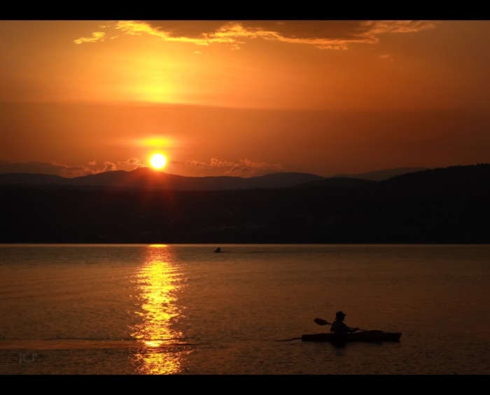 9.  Watch the sun set over the mountains from a kayak.