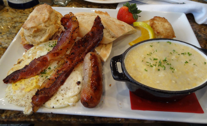 2. And then a full breakfast—with grits, sausage, and a biscuit.
