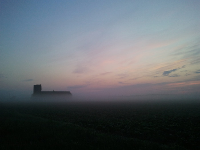 9. The faint outline of a barn and silo rise out of the morning mist in Lewes.