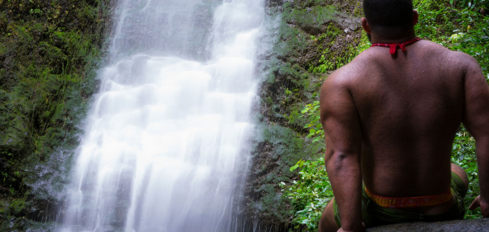 8. Hang out under a cascading waterfall.