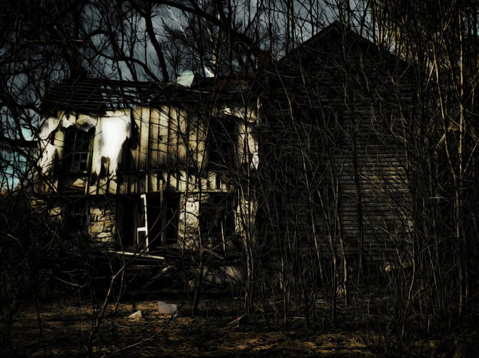 7. An old abandoned house looks haunted in the fading light.