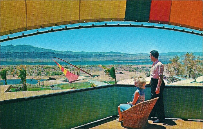 9. This looks to be a print ad for the Lake Havasu Hotel, with vacationers sitting on the observation deck.