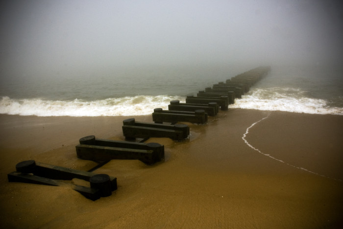 6. The fog above the Atlantic Ocean makes the structure seem like it has no end, stretching into the sea.