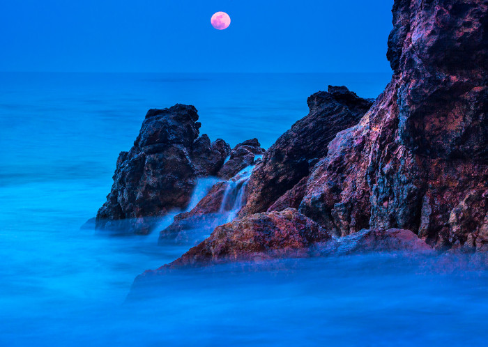 8. A glowing moon in Malibu hangs in the sky watching over the cliffs.