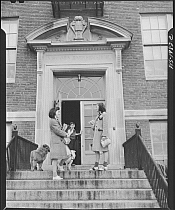 18, Having a morning chat on the high school steps in New Bedford. (1942)