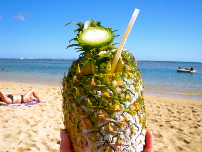 9. Drink cocktails on the beach, with sand between your toes. Bonus points if you're drinking from a pineapple.