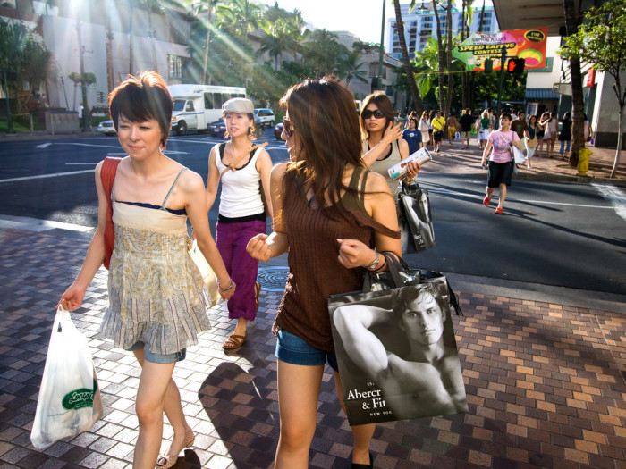 9. Tourists are the ones carrying tons of shopping bags around Waikiki.