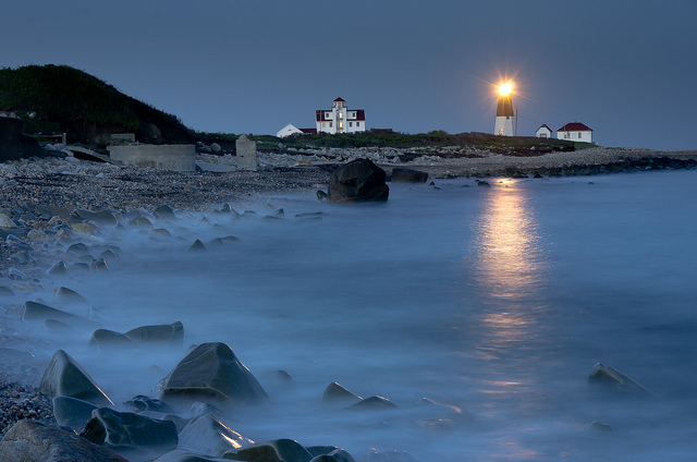 11. The light reflecting over the water from Point Judith Lighthouse is a mystical site.
