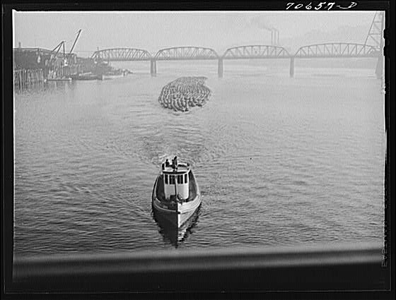 2. A tug boat pulling lumber down the Willamette River in Portland, 1941.