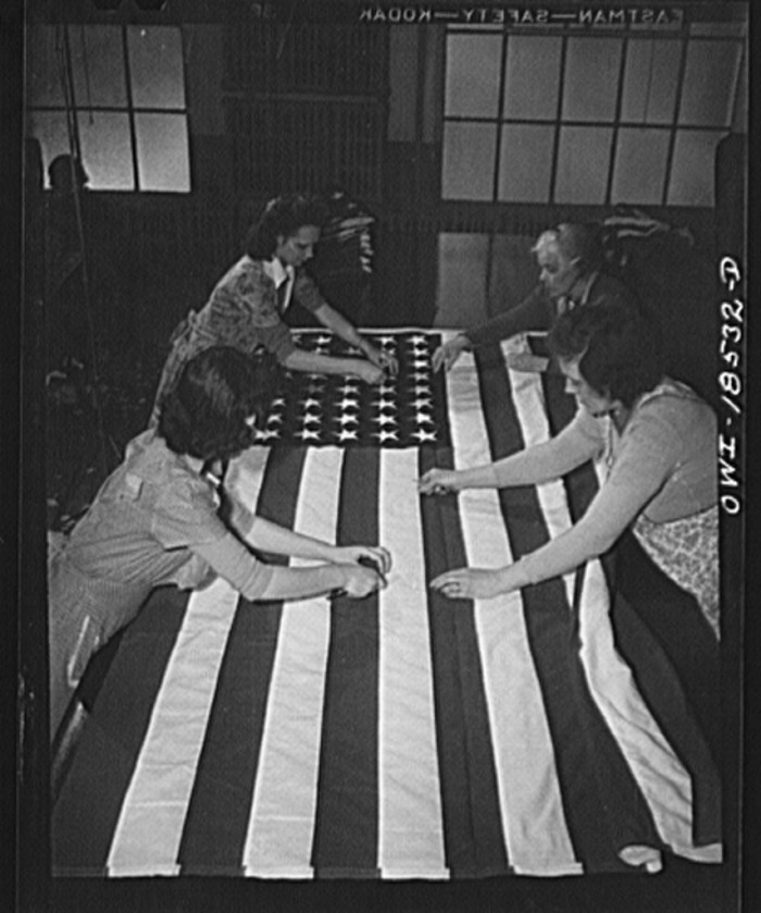 14. Women in a Verona factory trimming U.S. flags by hand, 1943.