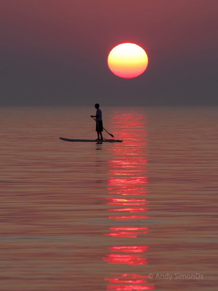 8. Learn how to paddle board.
