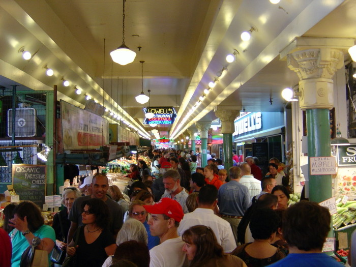 6. Seattle locals trying to shop at Pike Place Market during tourist season.