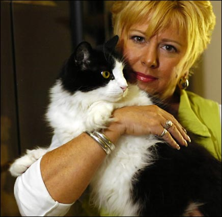 This is Lewis the Cat with his owner Ruth Cisero.