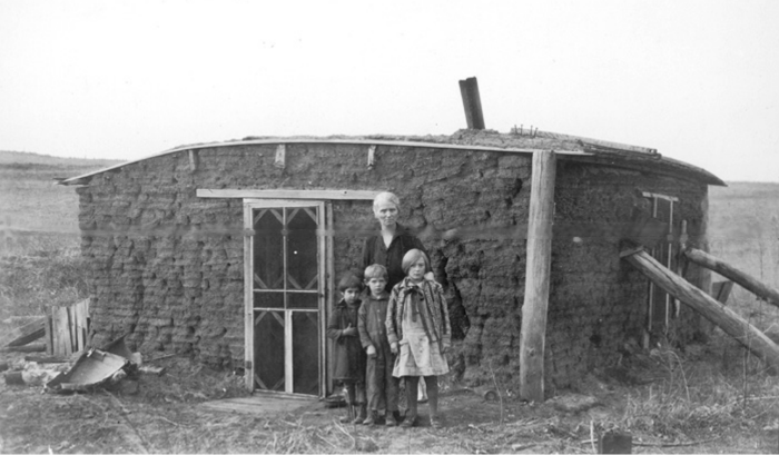 3. Logan County - undated. The teacher at this sod schoolhouse lived there during the school year. She taught her three students Sunday School material during the week.