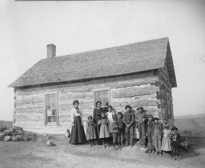 11. 10 miles north of Rushville - undated. A tiny log building provided all the space these children needed for their studies.