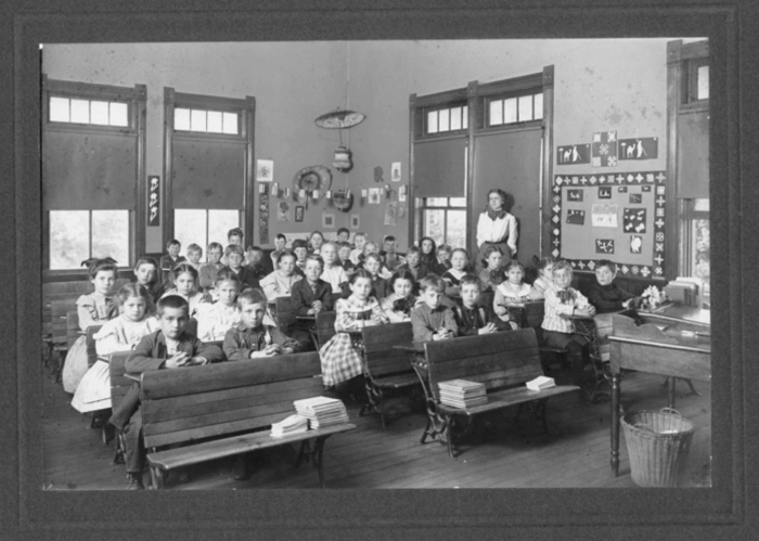 17. North School, Fremont - 1904. The pupils sit in double seats while the teacher's desk is in the front of the one-room schoolhouse.