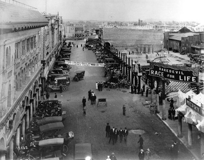 7. Venice, CA in 1913 on Windward Avenue. The banner is announcing a game between the Chicago White Sox and Venice Tigers.