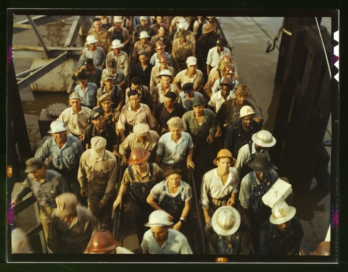 4. A group of tired workers leaves the Beaumont shipyards after a long day of contributing to the war effort.