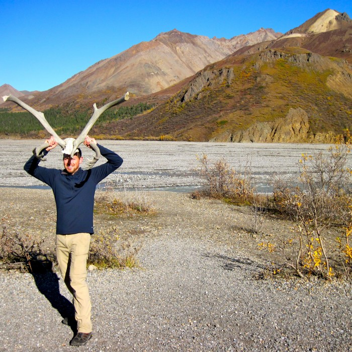 """2. Pose With Antlers: Because nothing says """"rugged"""" like pretending to be a caribou."""