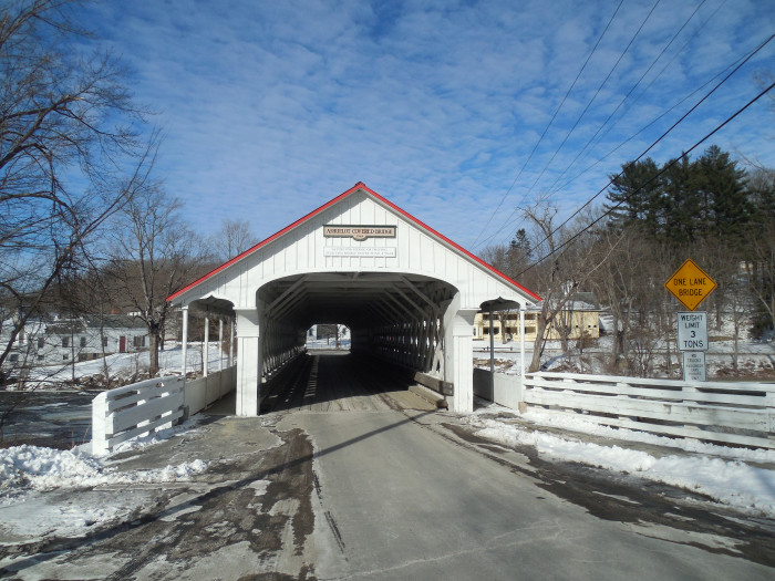 9. This covered bridge in Ashuelot has a red roof.