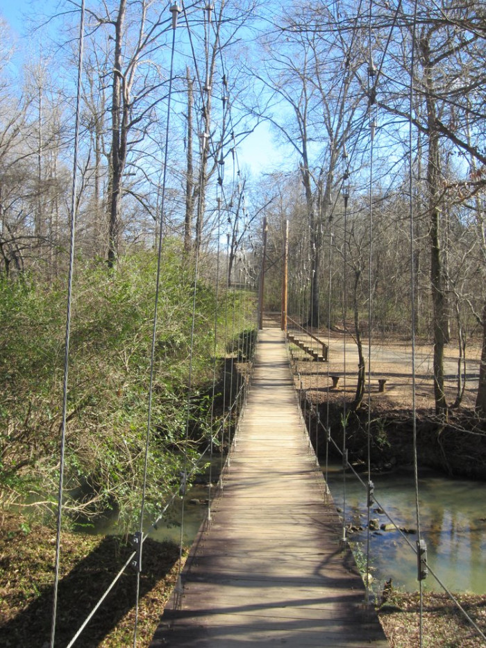 Like walking over wooden planks suspended high above a flowing river...