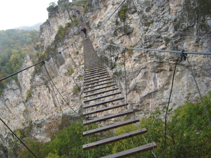 Nelson Rocks, a largely privately owned rock formation under the name NRocks Outdoor Adventures in Pendleton County, has a foot bridge that will make your knees weak.The bridge is 150 feet high and 200 feet across. As you can see, the bridge is made of wood slats and cable.