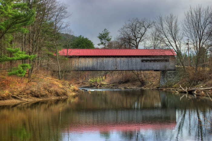 13. The Coombs Covered Bridge in Winchester is reflected on a stormy day.