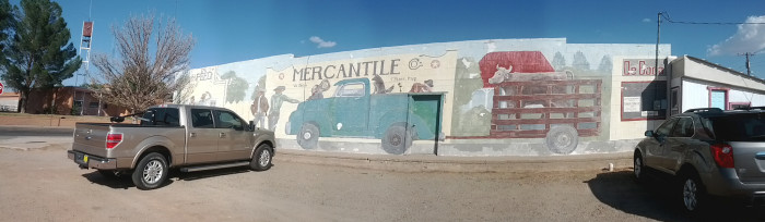 9. Part of a mural's job is to smoothly incorporate a building's architectural details. This mural, in Fort Sumner, does precisely that. Look at how the back of the truck covers the door, a bit like a tailgate!