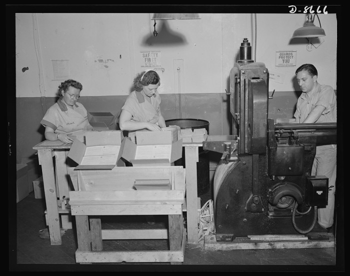 3. The men handle the printing machines while the women pack the books. Hoboken, 1942.