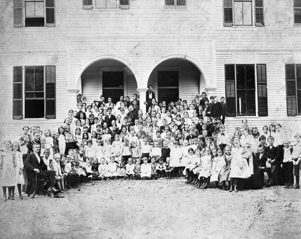 Students posed in front of the third public school