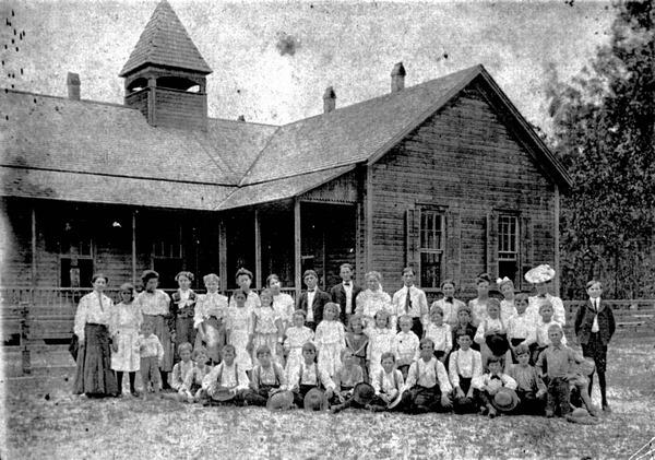 Class portrait before school building
