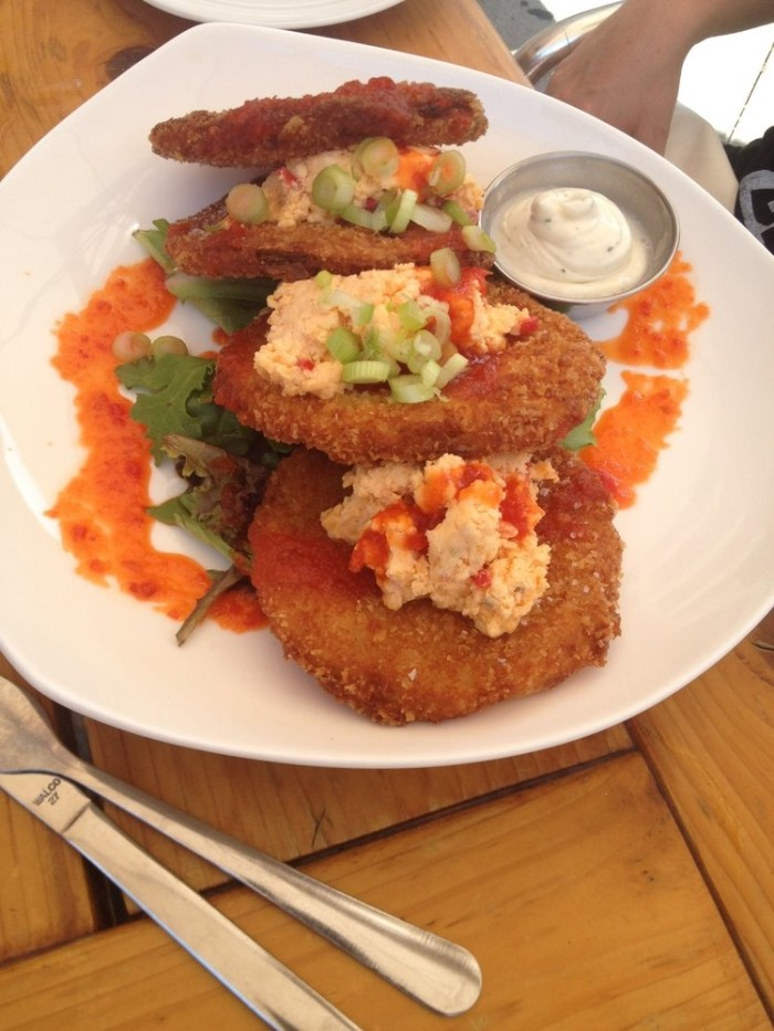 2. Fried green tomatoes topped with pimento cheese.