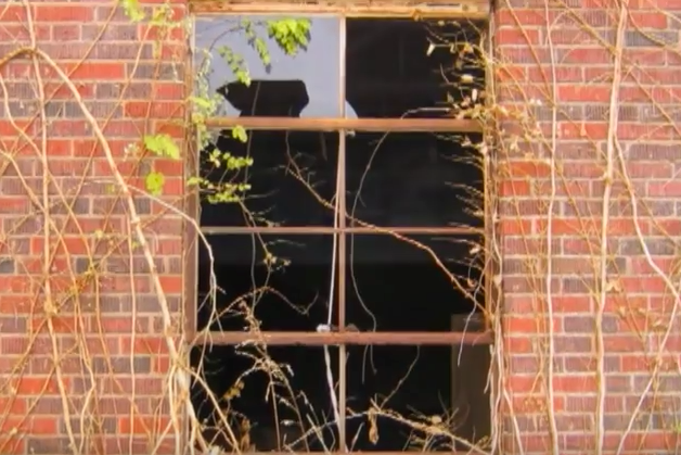 Residents say this abandoned building is rumored to be haunted. Apparitions have been seen in third-floor windows and throughout the building.