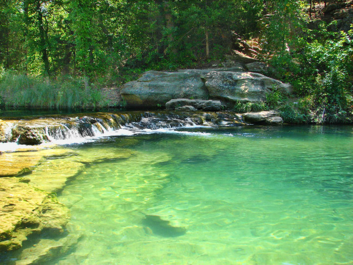 15. While in Sulphur, head over to Travertine Creek and take a dip in the cold, natural springs.