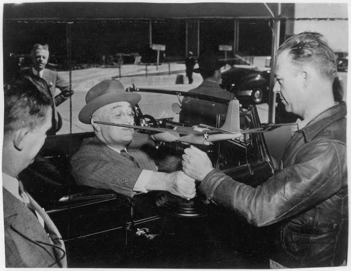 3. Franklin D. Roosevelt and plant workers in Tulsa, Oklahoma, 1943.