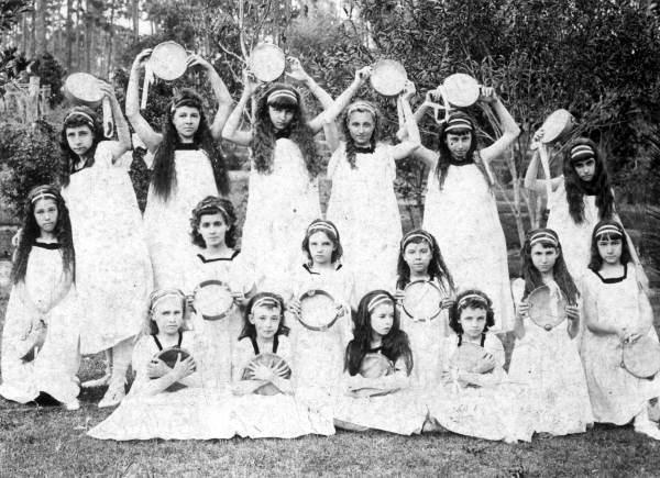 School dance group holding tambourines
