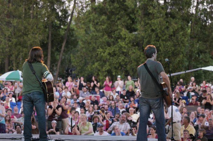 6. Jam at an outdoor concert.