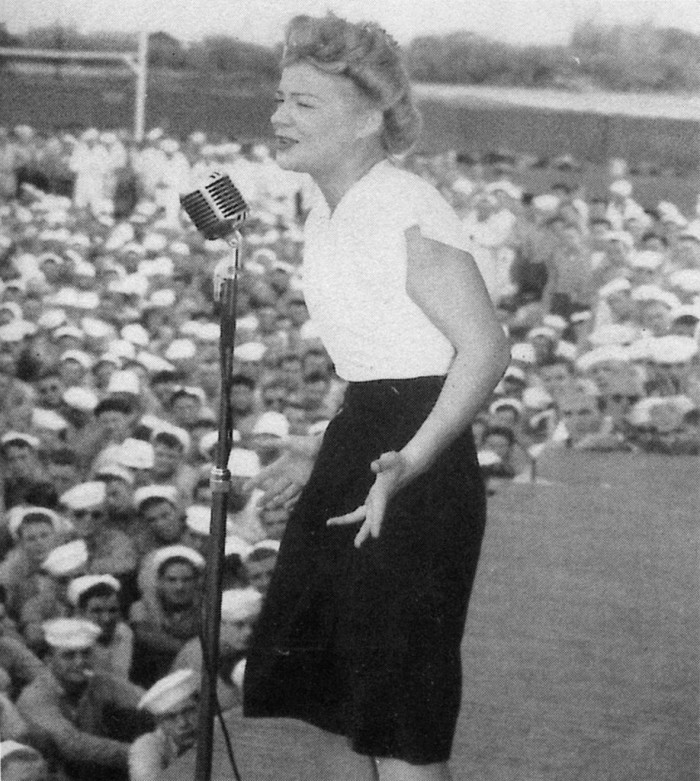 12. Singer Betty Hutton performs for service members in June 1945 at Naval Air Station Kaneohe.