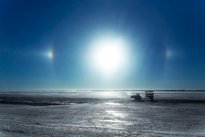 7. Sun dogs on a chilly morning near Fargo almost look like they outline a huge nearby planet that could be seen from another planet's glistening surface.