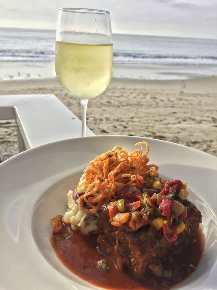 2. The Deck on Laguna Beach is a great way to enjoy the ocean breeze while you sip and nosh on tasty drinks and eats.