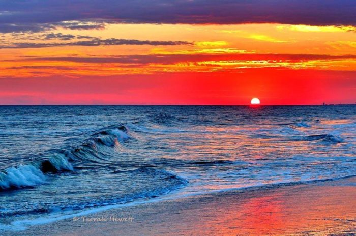 2. A colorful sunset over Holden Beach is the perfect way to end your day.