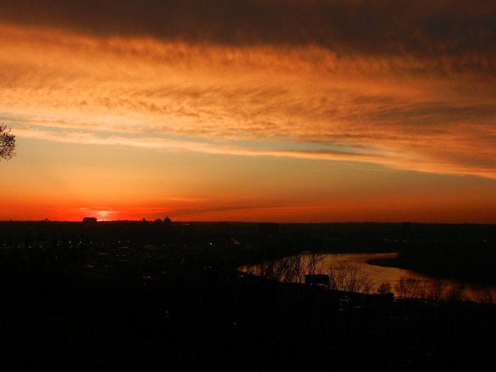 6. Not even the big city lights can dampen the vibrant colors of a Kansas sunset.