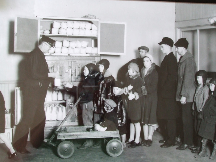 19. The Leonard Street fire department passing out bread and milk to the poor in Grand Rapids, Michigan.