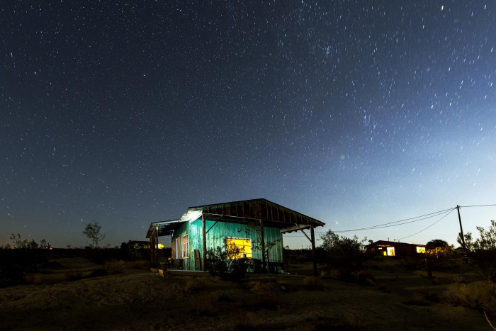 4. A cabin in Joshua Tree takes on a haunting glow after the sun goes down.